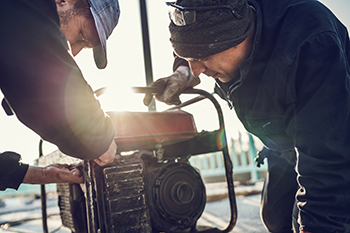 Workers Repairing Generator