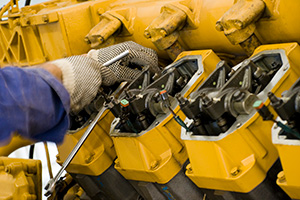 Gloved Hand Working On Generator