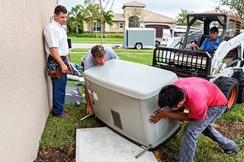 Four Technicians In the Process of Installing a Generator