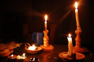 Several candles lit on a table during a blackout