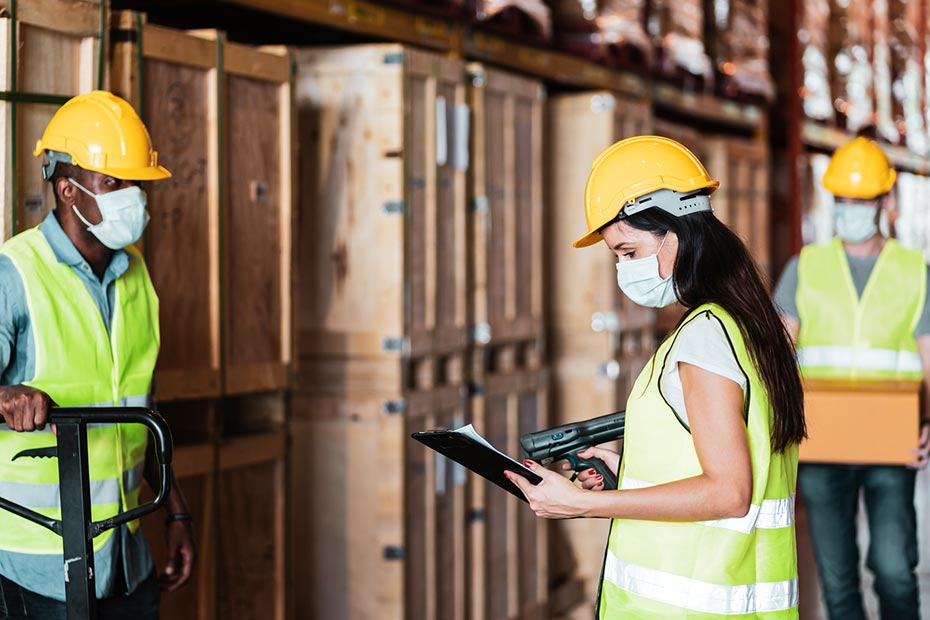 Technicians in Warehouse Practicing Social Distancing While Wearing Masks